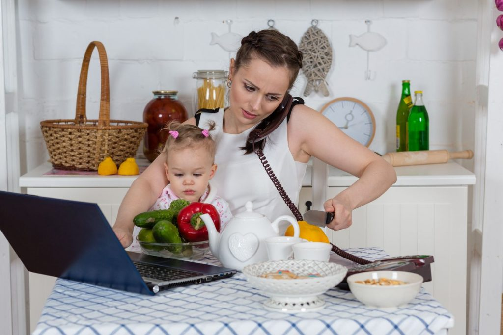 20109680 - young mother  with   little child sit at the dining table in the home kitchen.