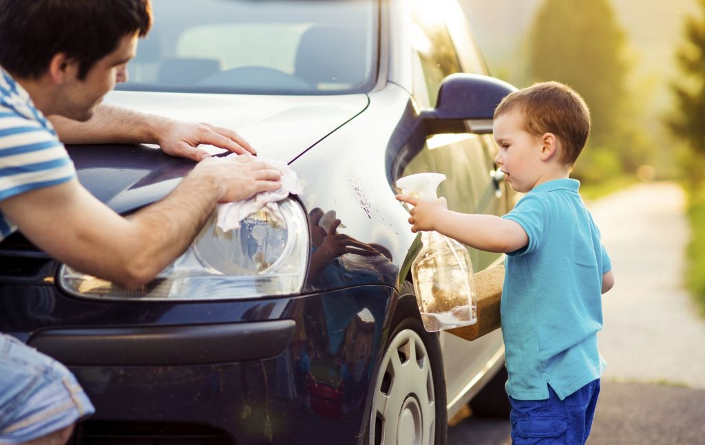 28858206 - young father with his little son washing car