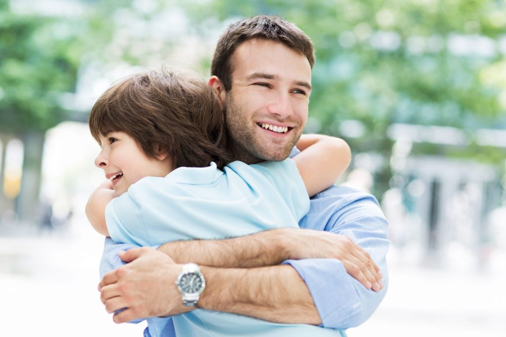 41255754 - father and son hugging