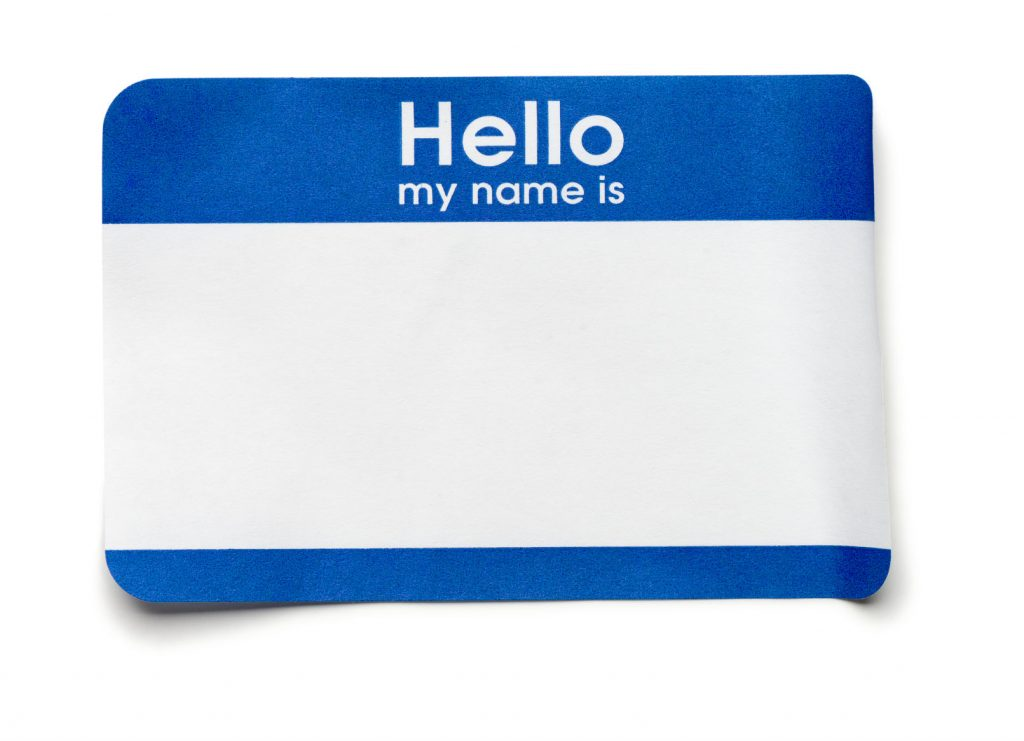31759686 - blue hello name tag on white