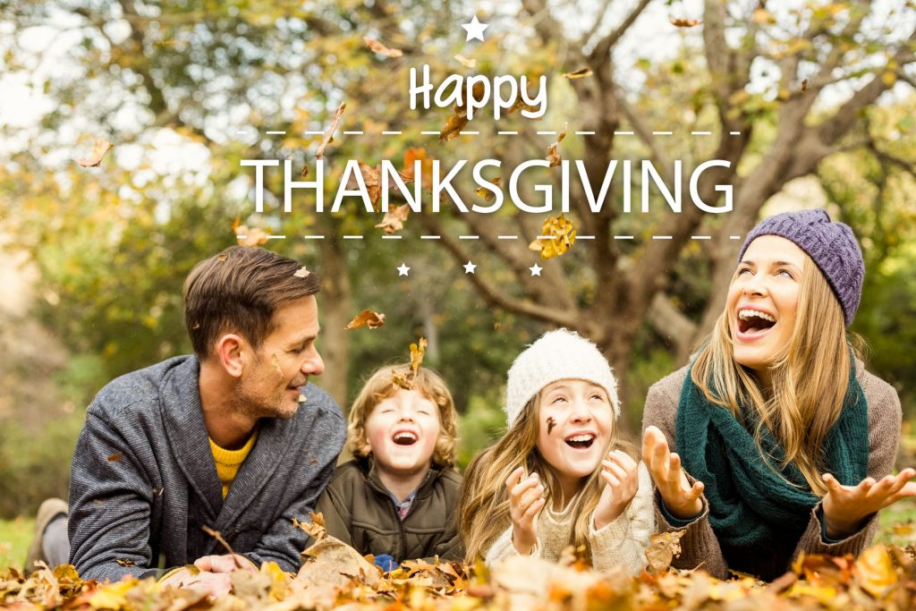 47543296 - happy thanksgiving against smiling young family throwing leaves around
