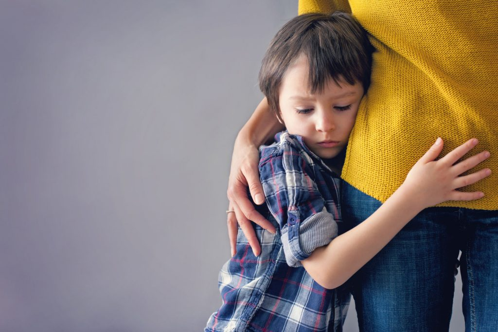 54222012 - sad little child, boy, hugging his mother at home, isolated image, copy space. family concept